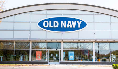 Bay Shore, New York, USA - 25 April 2020: The front of an Old Navy store in a strip mall empty due to the cdc rules during the coronavirus COVID-19 pandemic.