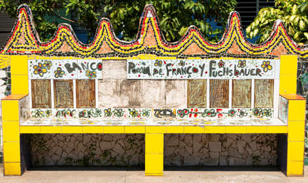 Fusterlandia, Cuba - 26 July 2018: A bench is decorated in colorful tiles in the tourist destination of Fuserlandia Cuba.