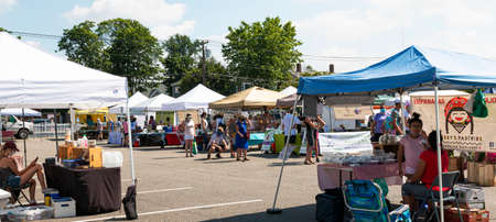 Babylon, New York, USA - 28 June 2020: The Babylon farmers market is set up and open for business during the coronavirus COVID-19 pandemic.