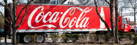 West Islip, New York, USA - 6 April 2021: Side view of a large Coca Cola truck delivering soda and parked in a stores parking lot. Editorial