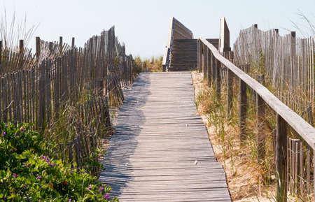 Walkway over the dunes of Fire Island to get to the beach with wooden fences and wood walkway over the sand.from the community of Summer Club. Stockfoto