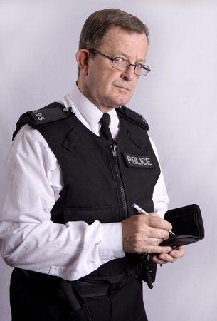 metropolitan: UK Police officer taking notes Stock Photo
