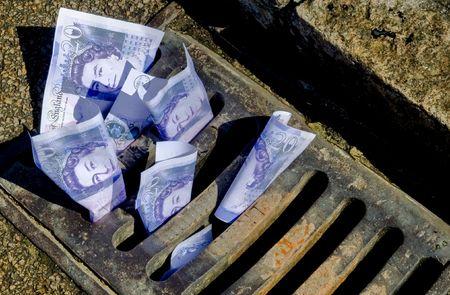 lost money: Money down the drain Stock Photo