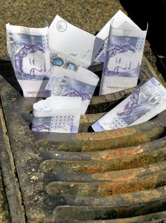 throwaway: Money down the drain Stock Photo