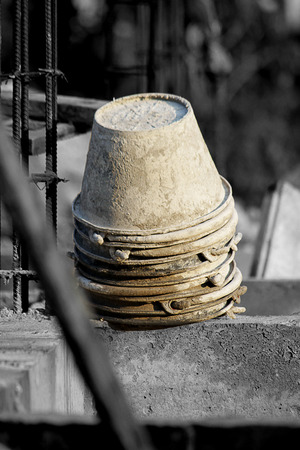 Bucket stacked in construction, Background gray photo