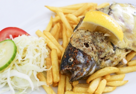 Grilled trout with chips photo