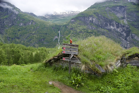 steep cliffs sign: Signpost above Geirangerfjorden in Norway Stock Photo
