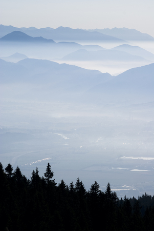 faraway: Mountain in fog with forest silhouette