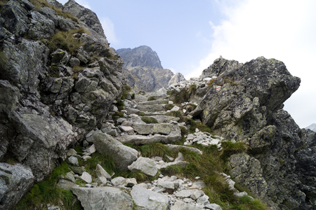 faraway: Red Marked mountain trail. Stone stairs in Difficult rocky terrain. Tatra Mountains. Slovakia