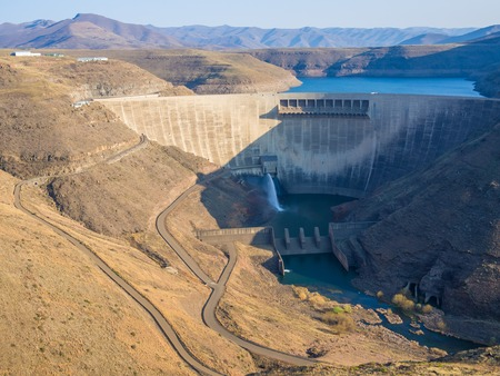 Impressive Katse Dam hydroelectric power plant and service roads in Lesotho, Africa Stock Photo
