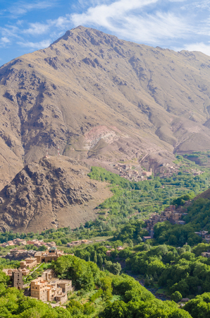 View on beautiful High Atlas Mountains landscape with lush green valley and rocky peaks, Morocco, North Africa