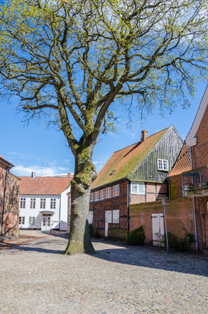 Historical red brick buildings in small Danish town Tonder during early spring, Denmark, Europe Editorial