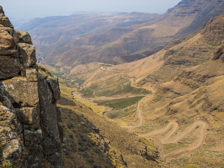 curve: The famous Sani mountain pass dirt road with many tight curves connecting Lesotho and South Africa Stock Photo