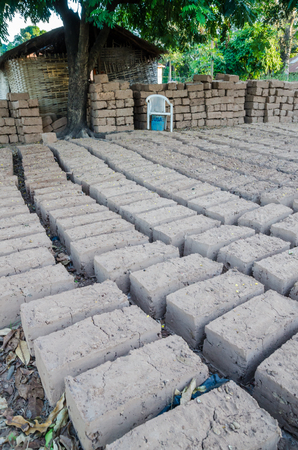 tradition: Traditional handmade clay brick for house building being dried outside, Bubaque, Bijagos islands, Guinea Bissau, Africa Stock Photo