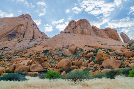 Landscape with famous red Spitzkoppe mountain and dramatic sky, Damaraland, Namibia, Southern Africa