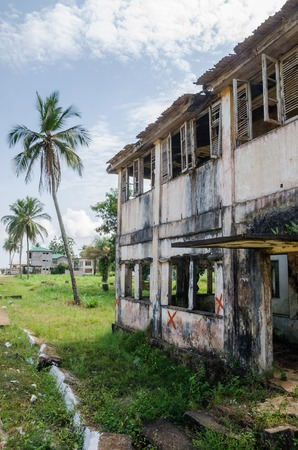 Abandoned and fading house in Robertsport, traces of civil war, Liberia, West Africa