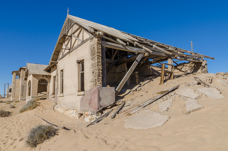 Ruins of once prosperous German mining town Kolmanskop in the Namib desert near Luderitz, Namibia, Southern Africa Stock Photo