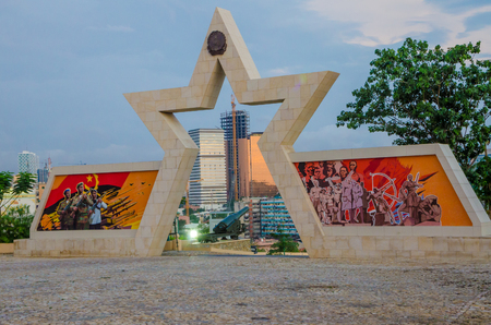 LUANDA, ANGOLA - APRIL 28 2014: Civil war memorial depicting Angolan flag and soldiers at Fortaleza de Sao Miguel