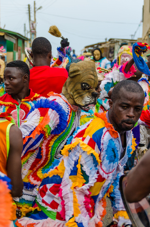 Cape Coast, Ghana - February 15, 2014: Colorful masked and costumed dancers during African carnival festivities Editorial