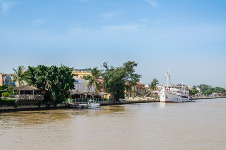 Senegal River with waterfront and historical ship in town Staint-Louis