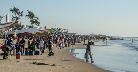 Return of the fishermen in wooden boats at beach in Casamance