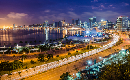 Skyline of capital city Luanda, Luanda bay and seaside promenade with highway during afternoon, Angola, Africa 免版税图像