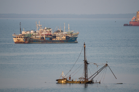 Freetown, Sierra Leone - January 09, 2014: Old and abandoned ships and ship wrecks rusting away at coast of Sierra Leone
