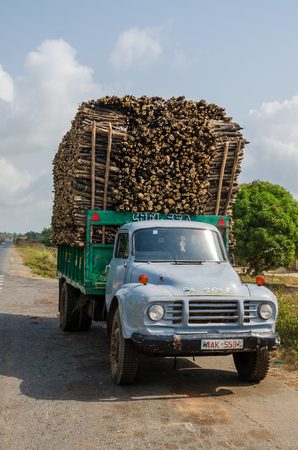 Bo, Sierra Leone - January 15, 2014: Heavily loaded classic truck transporting stacked timber