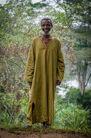 Potoru, Sierra Leone - January 22, 2014: Unidentified African village chief standing outdoors smiling