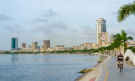 Luanda, Angola - April 28 2014: Bay of Luanda with seaside promenade and man on bicycle Redakční