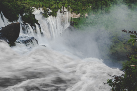 Kalandula waterfalls of Angola in full flow with lush green rain forest, rocks and spray, Africa Reklamní fotografie