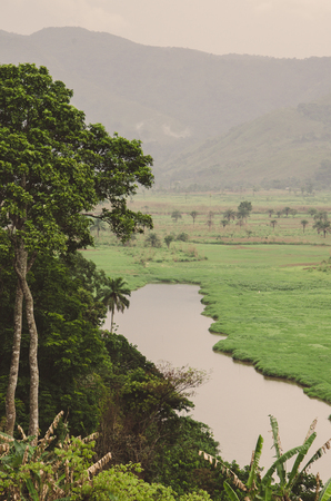 River with mountains and lush vegetation at Ring Road in Cameroon, Africa