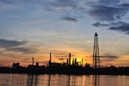 Oil refinery plant at sunset photo