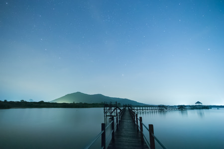 background of bridge and stars in blue sky and lake.Pranburi District Prajuab Kirikhan province Thailand. The Chaipattana Foundation Stock Photo