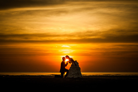 mate married: couple kiss a romance in the middle of sunrise