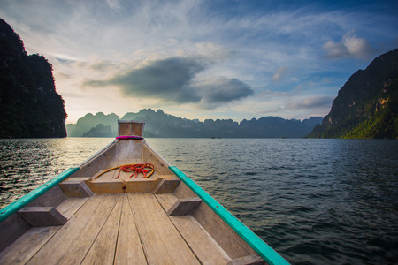 thani: Chiewlarn dam in Surat Thani Thailand. Traveler going to resort with boat. Relaxation among beautiful nature and fresh air.