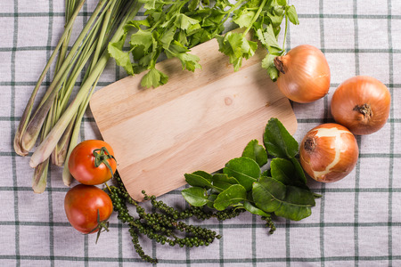 Vegetable framing on fabric background  photo