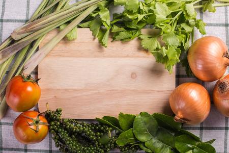 Vegetable framing on fabric background  photo