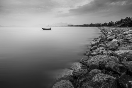 doleful: The ship is lonely. it is a beautiful in peaceful. and image is black and white color. Stock Photo