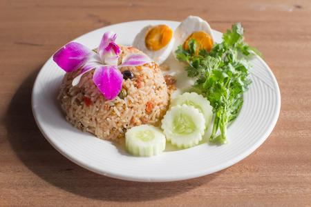 pat: Thai food menu is Fried Rice in a Boat. or Kao Pat Nam Pik Long Reu.