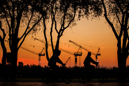 reconstruct: Construction in morning. People cycling a bike in the sanamluang park. Stock Photo