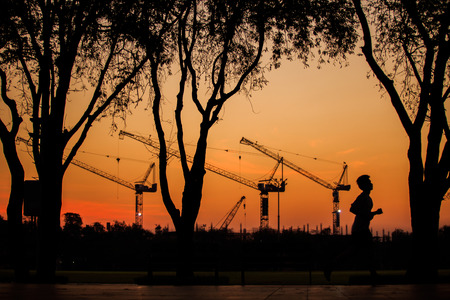 purge: Construction in morning. Man running in the sanamluang park.