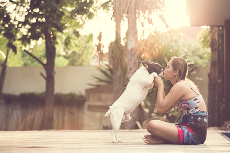 romantic kiss: Women hugging a dog and kiss. Them playful and happiness.