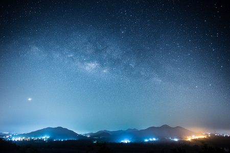 city by night: Milky way and full stars in the night. Background of mountain. Stock Photo