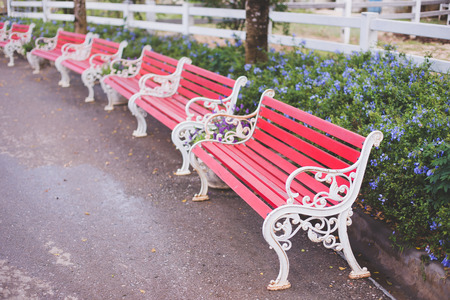 ouside: Red bench in the garden. Stock Photo