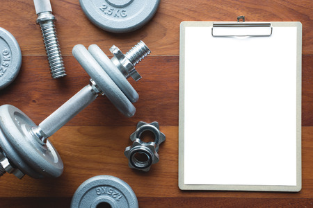 power tools: White paper board and exercise tool. Concept for application form or other message. Stock Photo