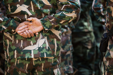 soldiers: Close up to backside of soldier hand. Stock Photo