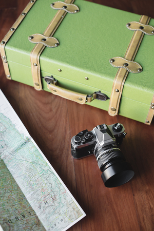 vintage voyage: Vintage luggage, film camera and map for travel concept Banque d'images