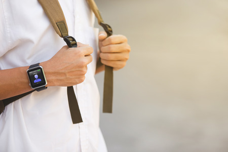 commune: Man wear smart watch in everyday lifestyle. He contact friend for anything. Concept for modern  lifestyle, businessman, Communication and other.