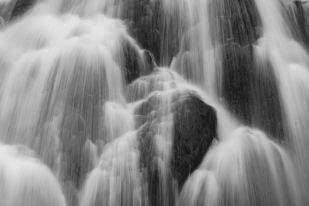 Fine art of waterfall. Black and white color.
